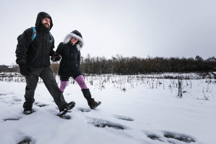 Karolina Jania and Brian Keith start their walk up the snowy Sidlaw Hills on Thursday, January 14 2021.