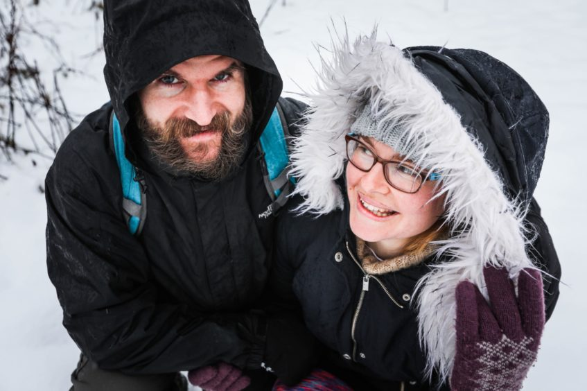 Karolina Jania and Brian Keith pose for a pic in the snow on the Sidlaws.