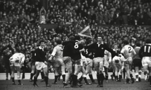 Scotland's Alistair McHarg celebrates with Peter Brown after victory in 1983 at Twickenham.