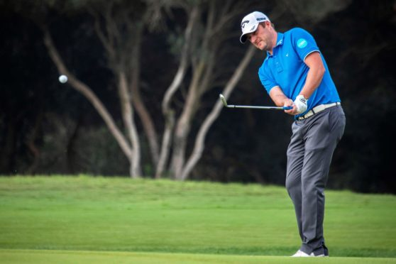 Marc Warren is just three behind going into the final round in Abu Dhabi.