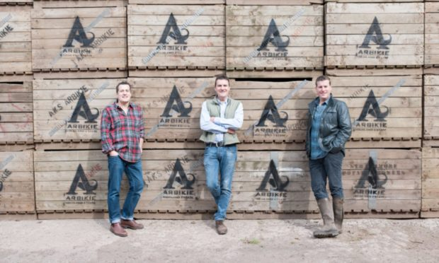 Iain Stirling, left, with his co-owner brothers John and David from Arbikie Distillery.