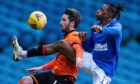Dundee United hitman Nicky Clark and Rangers midfielder Joe Aribo battle for possession at Ibrox last weekend.