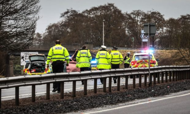 Police at the scene on the A90.