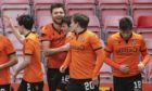 Dundee United celebrate Ryan Edwards' (No 12) goal up at Ross County.