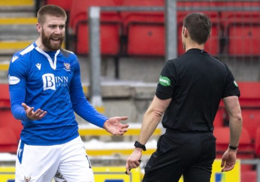 St Johnstone's Shaun Rooney claims for a second half penalty.