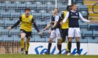 Queen of the South's Rhys Breen celebrates making it 2-0 at Dens Park.