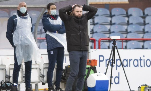 Dundee manager James McPake looks frustrated against Queen of the South.