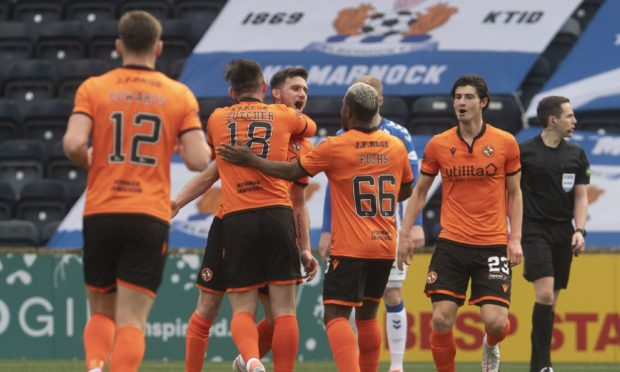 Adrian Sporle (centre) is congratulated by his team-mates after opening the scoring at Rugby Park.