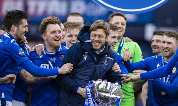 GLASGOW, SCOTLAND - FEBRUARY 28: St Johnstone's Murray Davidson lifts the Betfred Cup trophy during the Betfred Cup final between Livingston and St Johnstone at Hampden Stadium on February 28, 2021, in Glasgow, Scotland. (Photo by Alan Harvey / SNS Group)