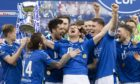 The victorious St Johnstone squad with their new silverware.