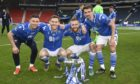 GLASGOW, SCOTLAND - FEBRUARY 28: St Johnstone's Michael O'Halloran, Jamie McCart, Shaun Roonet and Craig Bryson (l-R) with the Betfred Cup trophy during the Betfred Cup final between Livingston and St Johnstone at Hampden Stadium on February 28, 2021, in Glasgow, Scotland. (Photo by Rob Casey / SNS Group) **Free for first use ; 0ca92c10-791e-4a1b-ac60-347126e929a0