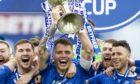 St Johnstone captain Jason Kerr lifts the Betfred Cup.