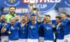 St Johnstone captain Jason Kerr lifts the trophy.