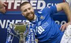 GLASGOW, SCOTLAND - FEBRUARY 28: St Johnstone's Shaun Rooney celebrates with the Betfred Cup trophy during the Betfred Cup final between Livingston and St Johnstone at Hampden Stadium on February 28, 2021, in Glasgow, Scotland. (Photo by Craig Williamson / SNS Group)