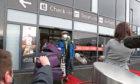Chun Wong and his daughter Kiernan, 8, leave Edinburgh Airport.