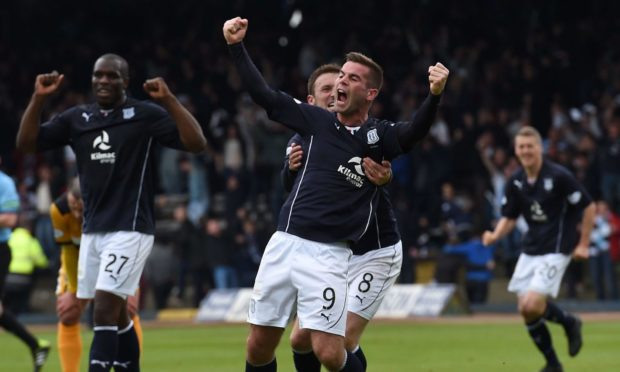 Peter MacDonald celebrates as Dundee are crowned winners of the Championship in 2014.