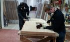 Corey Forsyth and Martin Wallace, first year joiners with Fife Council. They are carrying out tasks in the process of manufacturing a FD60 fire-resistant door. This work is completed in the councils purpose-built Joinery workshop at Bankhead, Glenrothes.