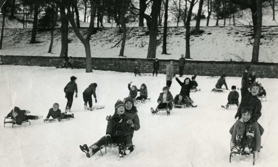 Fun in the snow at Lochee Park in December 1973.