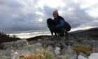 Gayle and dog Toby head up the Caterthuns in Angus.