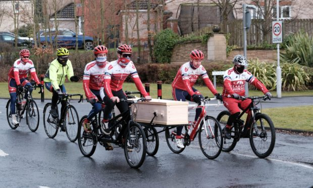 One last ride - Craig's coffin is carried to the crematorium.