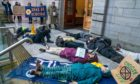 "Extinction Rebellion gathered for a ""die-in"" outside the city chambers ahead of a Dundee City Council meeting."