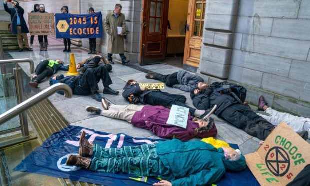 """Extinction Rebellion gathered for a """"die-in"""" outside the city chambers ahead of a Dundee City Council meeting."""