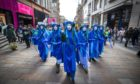 The Blue Rebels lead hundreds of people in the Blue Wave parade, organised by Extinction Rebellion, through Glasgow city centre.