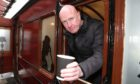 Evening telegraph/courier  news CR0026753 G Jennings pics , Dale Elder of the Bridgeview Station Cafe on Riverside Dundee is asking why the Costa in Tesco Riverside is able to sell coffee without using a hatch, thursday 18th