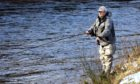 Angler Dave Morrison fishing on the Esk on opening day of the 2021 season.