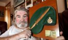 Evening telegraph/ Courier news CR0026795   G Jennings pics , 67 year old Stuart Lavery from Arbroath,  with a replica of the Royal Marine Commando Green Beret with Fairbairn Sykes Dagger Plaque which Stuart donated to ward 34 in Ninewells hospital and which has been stolen, monday 22nd february.