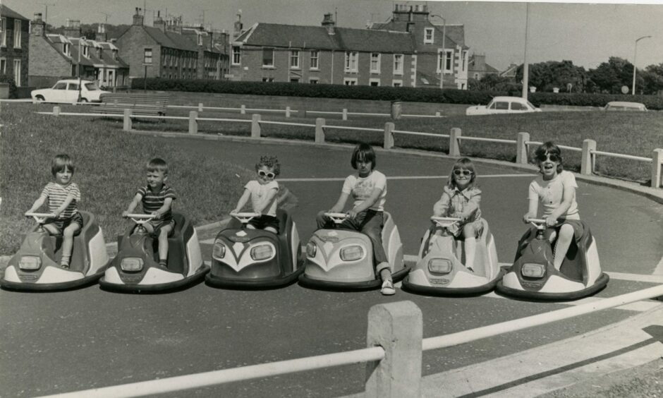 Children line up for a racing start at the Castle Green car track in 1975.