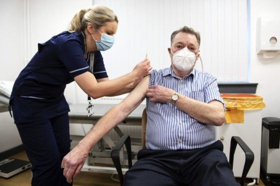 James Shaw, 82, was the first person in Scotland to receive the Oxford AstraZeneca vaccine from nurse Justine Williams at the Lochee Health Centre in Dundee