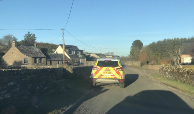 A police vehicle at Vinny Den in Letham.