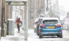 """Winds off the North Sea have caused drifting snow, increasing the likelihood that roads could be closed """"at very short notice""""."""