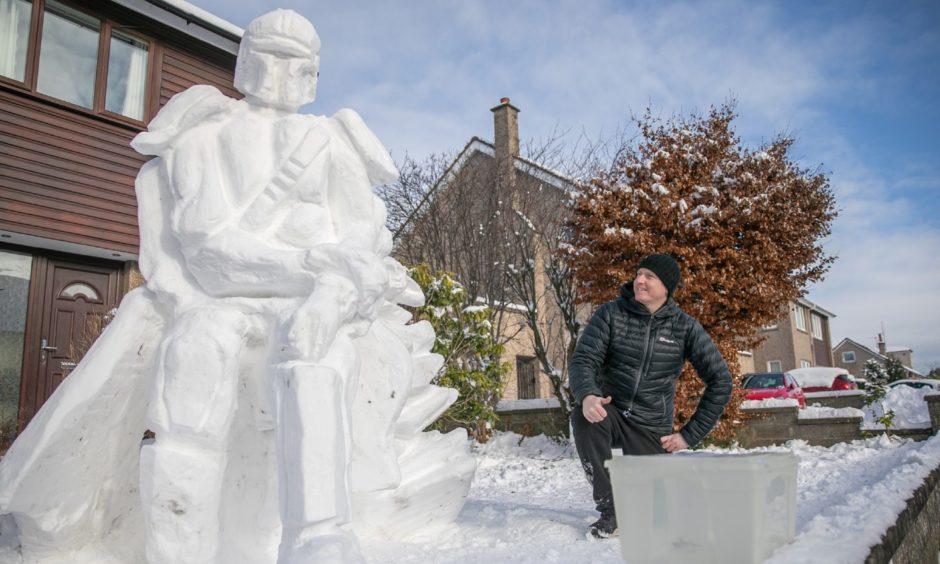 Douglas Roulston with his huge Mandalorian snowman.