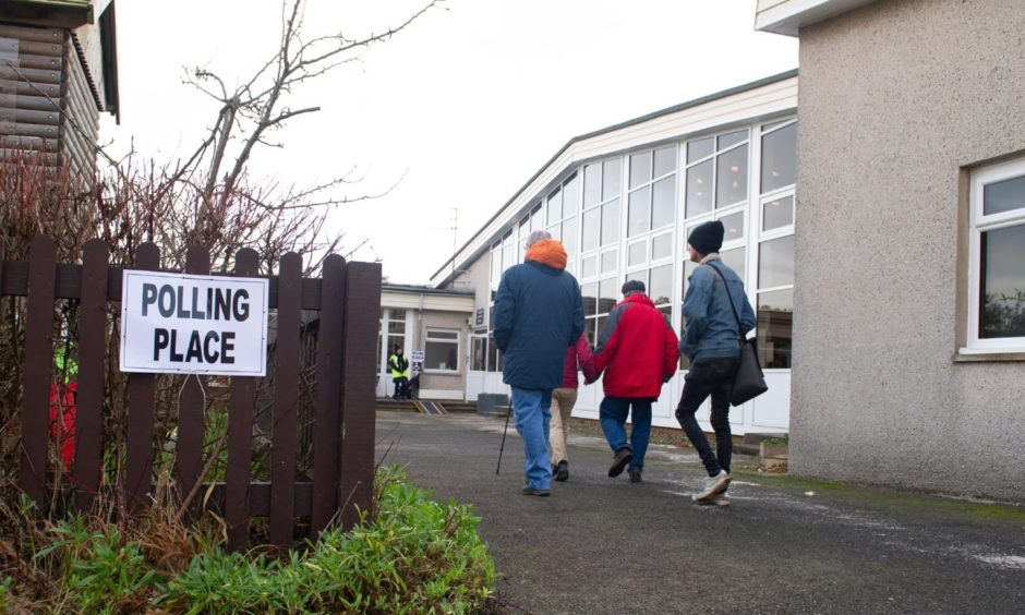 Courier News - Dundee  - Louise Gowans story - CR0017188 - General voting day pics, shots of people heading to the polls. Picture shows; voters heading into and out of a polling station in St Andrwews, Canongate Primary School, St Andrews, 12th December 2019, Kim Cessford / DCT Media.