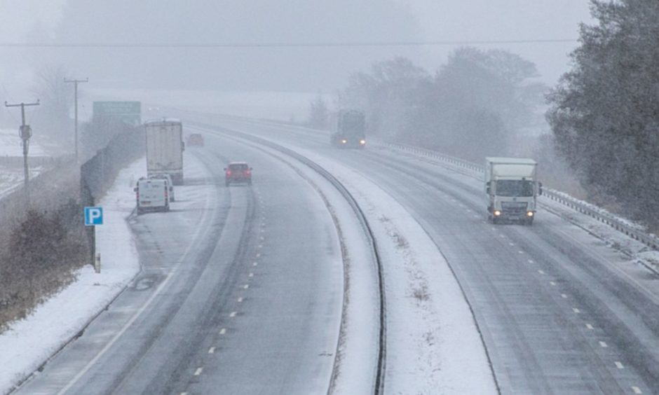 Tricky driving conditions on the A90 passing Forfar on Monday, February 8 during Storm Darcy.