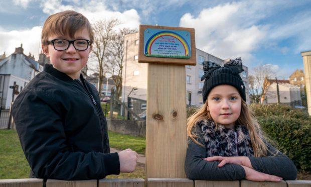 Jasper and Rose unveiled the plaque.