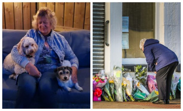 Margaret Wares, with Jackadoodle Dizzy on the right, and her daughter's dog Ruby on the left, and flowers outside her business The Laird's Larder, Monifieth.