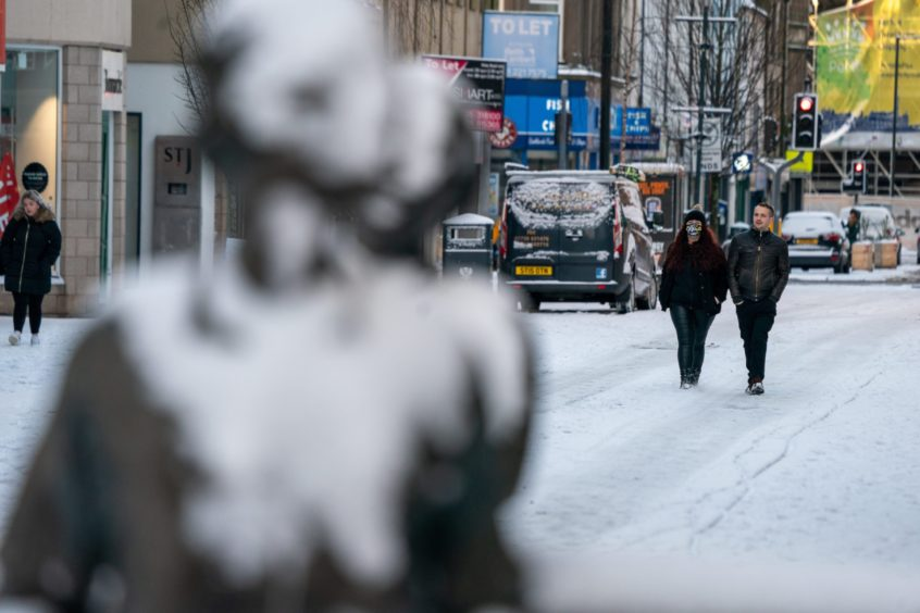 A few hardy souls still ventured out in the snow in Perth.
