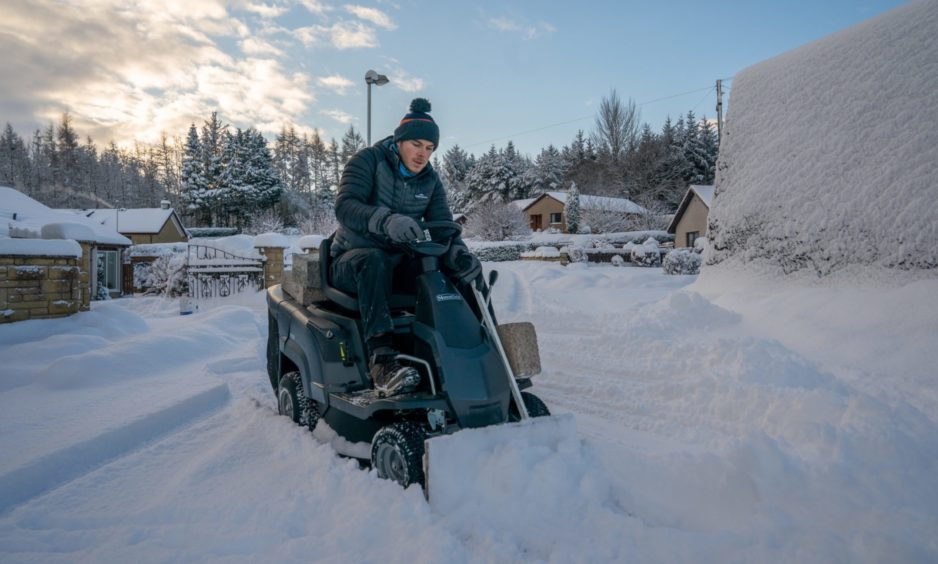 Dean Drew clears the access road to his cul-de-sac using his homemade snow plough in Perth on Wednesday, February 10 2021.