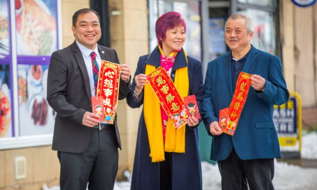 Andy Chan with mum Maria and dad Ian Chan, celebrated Chinese New Year today.