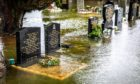 Graves and memorials lie under inches of water as flooding happens again at Ballingry Cemetery on Hill Road.