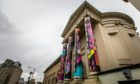 New artwork has been wrapped around columns at Perth Museum and Art Gallery.