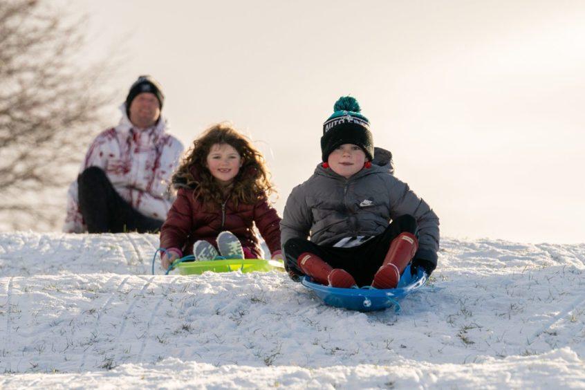 Conrad Melville races Ayla Swan down the slopes in Newburgh.