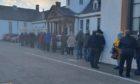 People queue outside Randolph Wemyss Hospital in Buckhaven.