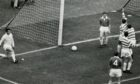Jimmy Donaldson can't prevent Bertie Auld's winner for Celtic.