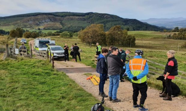 Rescuers flock to the remote site after Gordon Paterson was trampled.