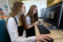 Criagie High School pupils Lea McLeod, left, and Keraleigh Simpson, at the Password Cracking workshop at Abertay University in Dundee