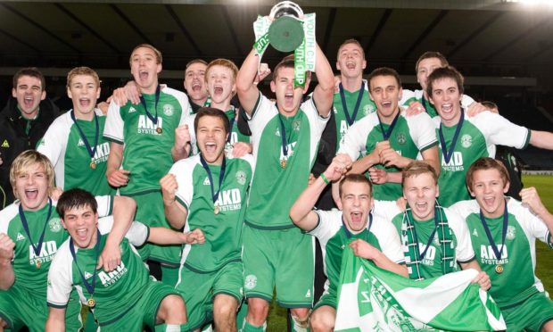 Callum Booth - standing, far right - and David Wotherspoon - standing, second from the left - celebrate the Hibs Scottish Youth Cup win.